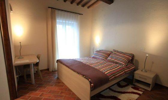 Una camera matrimoniale di Casa Ronald a Firenze