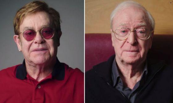 John e Caine testimonial pro vaccino contro il coronavirus